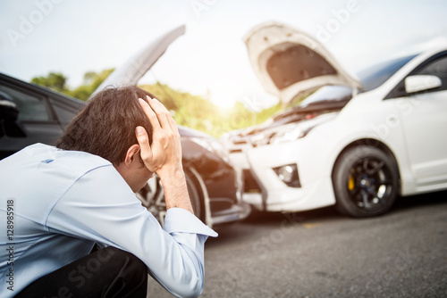 Foto  Asia man driver man in front of automobile crash car collision accident in city road