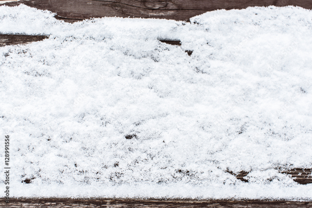 Snow on the wood background
