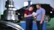 customer and mechanic discuss upcoming car repair