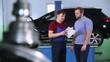 car service. client and engineer discuss plan car repair