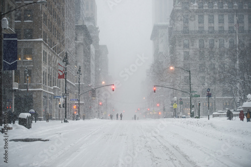 In de dag New York New York City Manhattan Midtown street under the snow during snow blizzard in winter. Empty 5th avenue with no traffic.
