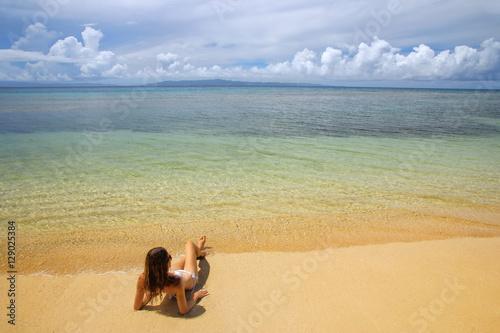 Foto op Aluminium Oceanië Young woman in bikini lying on the beach on Taveuni Island, Fiji
