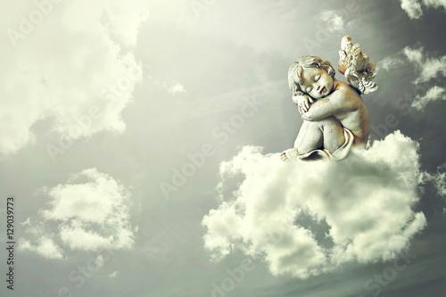 Photo Angel sleeping on the cloud