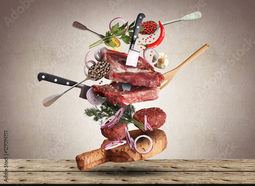 Poster Vlees Meat and beef meatballs with vegetables and utensils