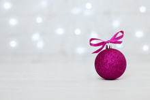 White Background. Pink Ball. The Concept Of Christmas