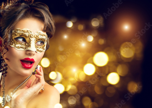 Foto op Aluminium Carnaval Beauty model woman wearing venetian masquerade carnival mask at party. Christmas and New Year celebration