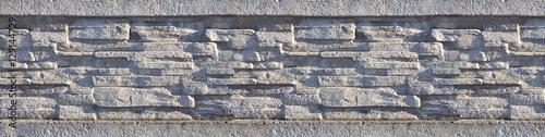 Fotografía  Stone fence texture - building feature