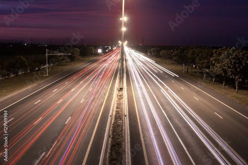Speed Traffic at light trails on motorway highway at night,backg