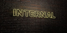 INTERNAL -Realistic Neon Sign On Brick Wall Background - 3D Rendered Royalty Free Stock Image. Can Be Used For Online Banner Ads And Direct Mailers..