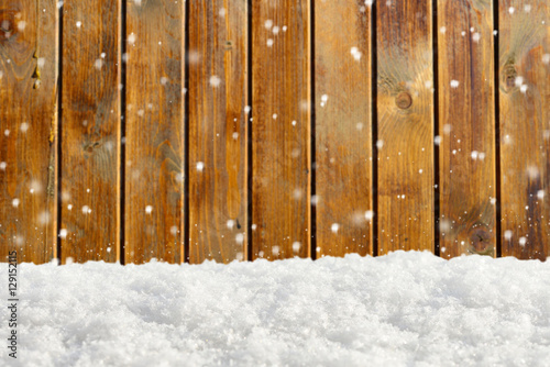 Tuinposter Metal Christmas background with snow and blurred wood texture