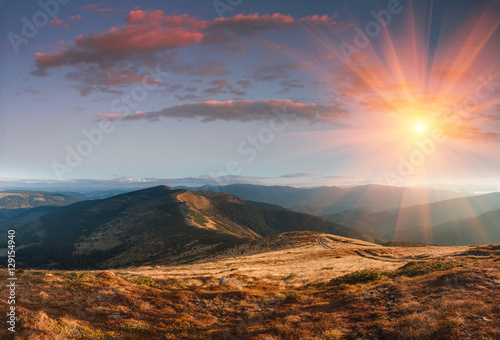 Panoramic landscape in the autumn mountains at sunset. #129154940