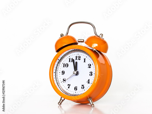 Orange Alarm Clock With Hands Showing Midnight Buy This Stock
