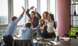 canvas print picture - Business people giving five after dealing and signing contract or agreement with partners abroad. Colleagues showing team work in office interior.