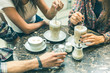 canvas print picture Multiracial group of friends having a coffee together
