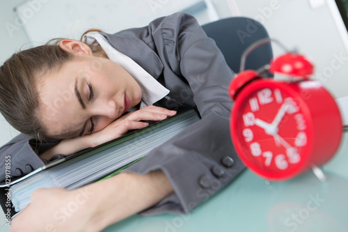 Valokuva  woman sleeping on table while working