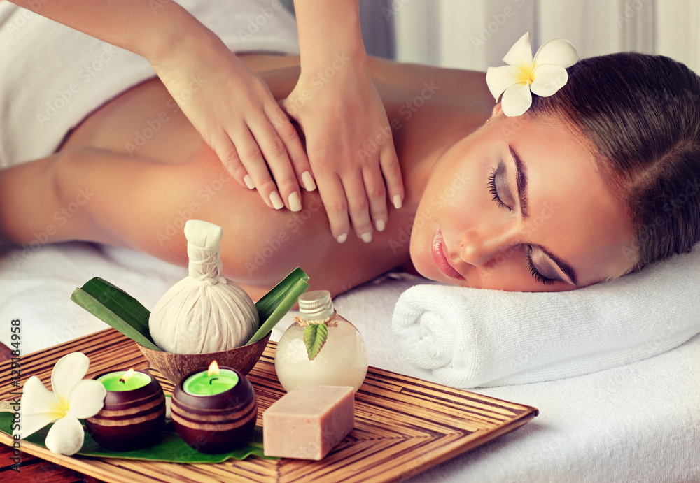 Fototapety, obrazy: Body care. Spa body massage treatment. Woman having massage in the spa salon