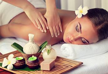 Fototapeta Body care. Spa body massage treatment. Woman having massage in the spa salon