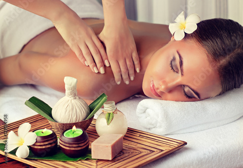 obraz PCV Body care. Spa body massage treatment. Woman having massage in the spa salon