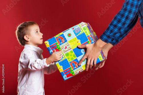 little boy give a gift for a holiday, Concept for family holiday