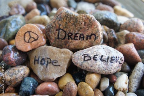 Fotografie, Tablou  Peace Sign, Dream, Hope, and Believe Written on Stones