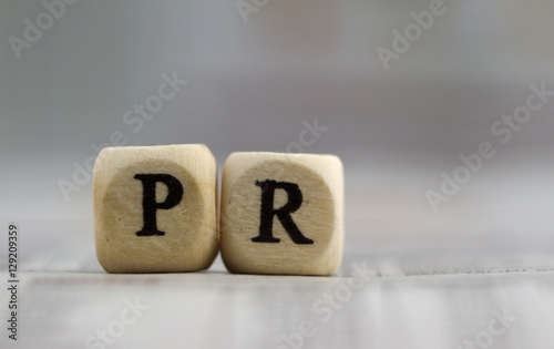 Foto  Public relation word on a business newspaper background