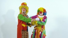 Circus Clown Taking A Box Away Of Another Clown