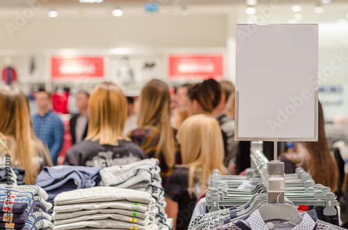 lot of people waiting in line at the store for the sale and purc - 129231319