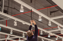 Worker Puts The Camera On The Ceiling