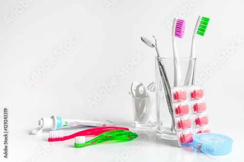 Fotografie, Obraz  toothbrushes in glass on white background tools for oral care
