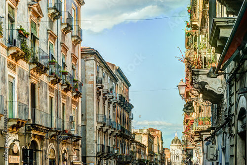 Fototapety, obrazy: Catania arhitecture - Street view with facades of residential houses, lanterns and roofs in warm sunset light. Catania, Sicily, Italy.