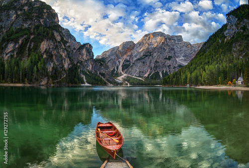 Fotografering  Boats on the Braies Lake ( Pragser Wildsee ) in Dolomites Alps, Sudtirol, Italy