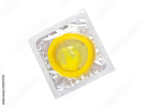Fotografía  Close up of a yellow condom on white background