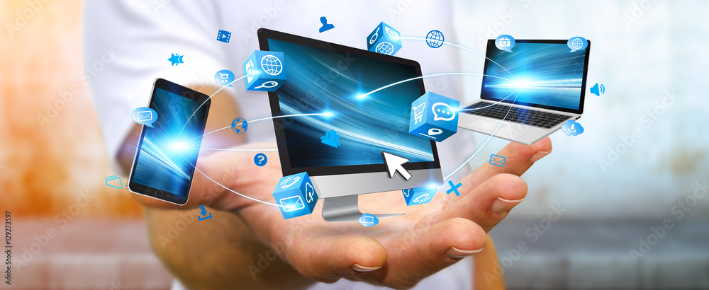 Fototapeta Businessman connecting tech device in his hand