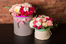Flowers And A Gift Box