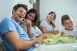Happy family having breakfast on bed