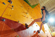 Handsome man spending day in climbing gym
