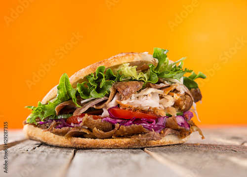 close up of kebab sandwich.