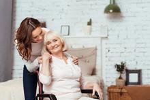Cheerful Elderly Woman Sittig In The Wheelchair