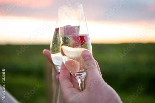 Close-up of couple toasting glass of champagne