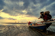 Beautiful sunset on the sea with traditional thai longtail boats.