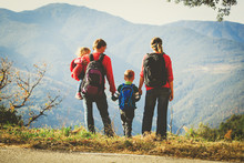 Family With Two Kids Hiking In...