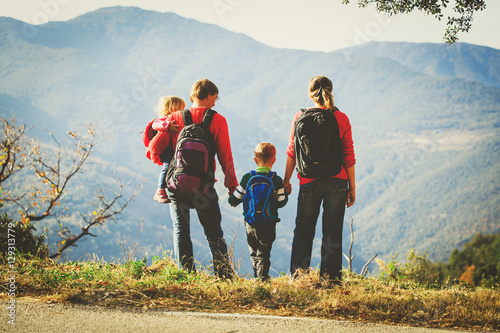 family with two kids hiking in mountains