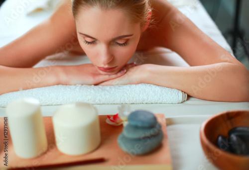 Fototapety, obrazy: Beautiful young woman getting spa massage, lying on salon