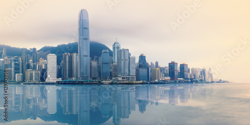 Photo  Hong Kong foggy evening on Victoria's harbour from Tsim Sha Tsui waterfront