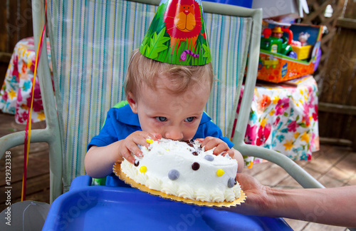 Fotografie, Obraz  Young Caucasian boy celebrates his first birthday with Cake outs