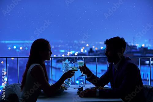 Fotografie, Obraz  Young couple at restaurant having dinner
