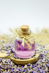 Obraz na płótnie Canvas Lavender essential oil in a small bottle.