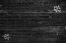 Pair Of Snowflakes On Dark Rustic Wood Background