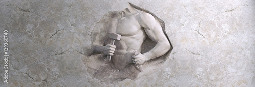Fotografia epic background of athletic man cuts his body of marble stone