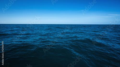 Poster Zee / Oceaan The vast ocean in the winter, Dark and deep ocean with blue sky